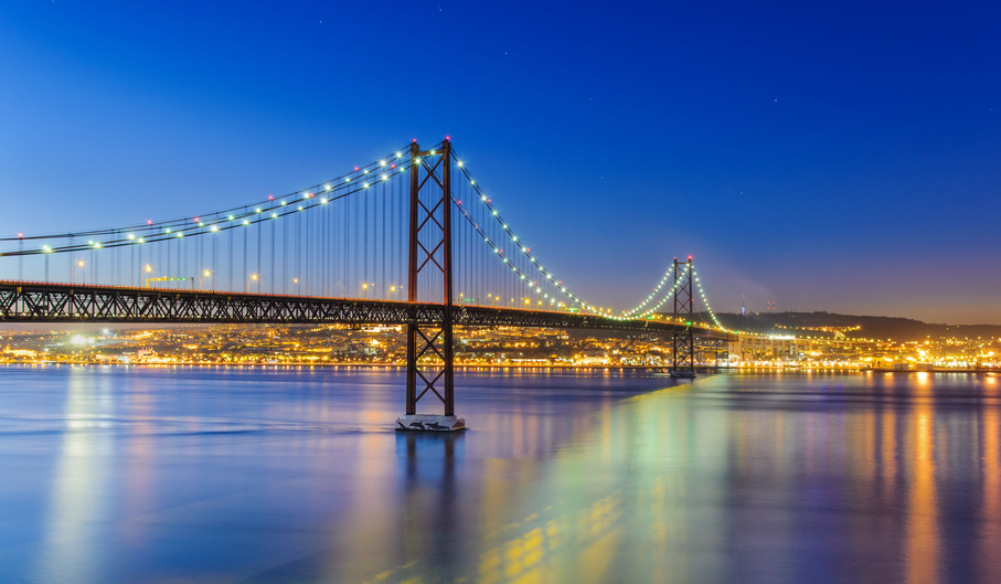 Night view of Lisbon and of the 25 de Abril Bridge, Portugal